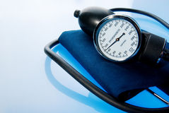 Sphygmomanometer on blue background Royalty Free Stock Photography
