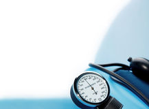 Sphygmomanometer on blue background Stock Images