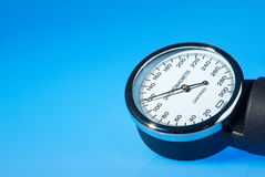 Sphygmomanometer on blue, reflective background Stock Photo
