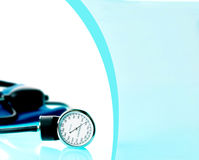 Sphygmomanometer on blue, reflective background Stock Image