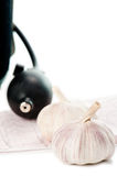 Sphygmomanometer, cardiogram and fresh garlic Royalty Free Stock Photo