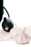 Sphygmomanometer, cardiogram and fresh garlic Royalty Free Stock Photo
