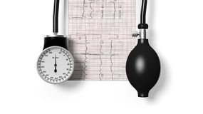 Sphygmomanometer and cardiogram Stock Photography