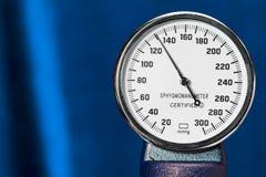 Sphygmomanometer closeup, blood pressure measurment medical equipment. Tonometer, medical tool on blue background, close. Up high resolution stock photos