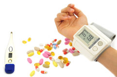 Sphygmomanometer and drugs Royalty Free Stock Images