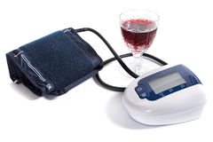Sphygmomanometer and glass of red wine Royalty Free Stock Photo