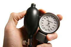 Sphygmomanometer in hand Royalty Free Stock Images