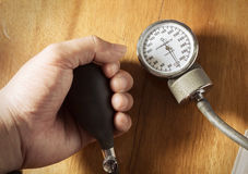 Sphygmomanometer in hand. Stock Images