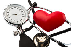 Sphygmomanometer and heart Royalty Free Stock Photos
