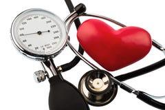 Sphygmomanometer and heart Stock Photos