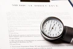 Sphygmomanometer on medical directive document. (medical background Stock Images