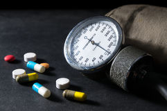 Sphygmomanometer with medicine pills Royalty Free Stock Images