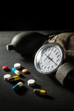 Sphygmomanometer with medicine pills and capsules. Royalty Free Stock Image