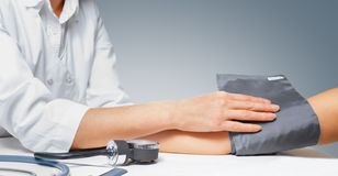Sphygmomanometer on the patient's arm Stock Image