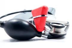 Sphygmomanometer, stethoscoop en reflexhamer Stock Foto's