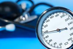 Sphygmomanometer and stethoscope. On blue background stock images