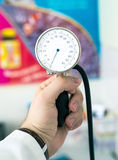 Sphygmomanometer. Using sphygmomanometer - blood pressure measurement device Stock Photos