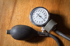 Sphygmomanometer on wood table. Royalty Free Stock Photo