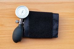 Sphygmomanometer on wooden texture background royalty free stock photography