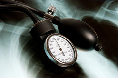 Sphygmomanometer on Xray photo Stock Image