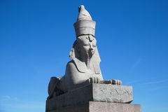 Sphynx. Authentic antique Egyptian sphynx on quay of the Neva river against  sky in Saint-Petersburg, Russia Stock Images