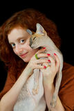 Sphynx cat and Red-haired girl Royalty Free Stock Image