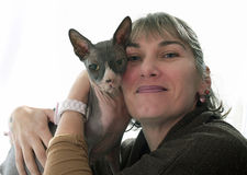 Sphynx Hairless Cat and woman. In front of white background Stock Images