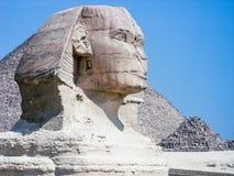 Sphynx head in Giza, Egypt. Sphynx against a blue sky, El Cairo, Egypt Royalty Free Stock Photos