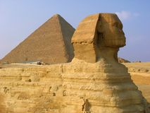 Sphynx and pyramids in Giza.  Royalty Free Stock Photo
