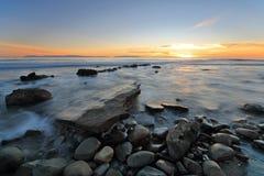 Spiaggia al crepuscolo Fotografia Stock Libera da Diritti
