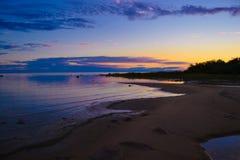 Spiaggia al tramonto Fotografia Stock Libera da Diritti