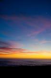 Spiaggia al tramonto con la luna Fotografia Stock Libera da Diritti