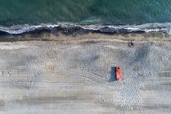 Spiaggia alla vista aerea di tramonto Fotografia Stock