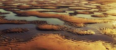 Spiaggia astratta al fondo strutturato di tramonto fotografia stock libera da diritti