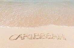 Spiaggia caraibica con testo nella sabbia Immagine Stock Libera da Diritti