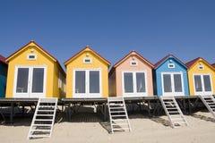 Spiaggia-case colorate Fotografie Stock