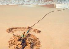 Spiaggia con l'ancora Immagine Stock