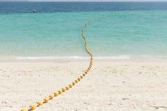 Spiaggia del mare con le boe gialle Fotografie Stock