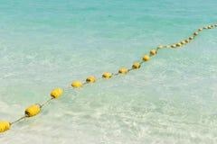 Spiaggia del mare con le boe gialle Fotografie Stock Libere da Diritti