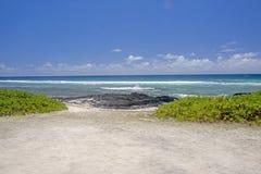 Spiaggia dell'Oceano Indiano un cielo fotografia stock libera da diritti