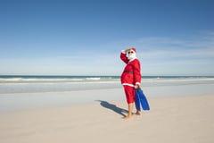 Spiaggia di festa di natale del Babbo Natale Fotografia Stock