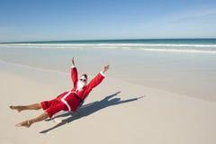 Spiaggia di festa di natale del Babbo Natale Fotografia Stock Libera da Diritti