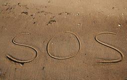 Spiaggia di guida di SOS Immagini Stock
