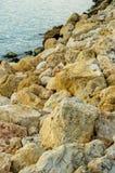 Spiaggia di pietra di struttura Fotografia Stock