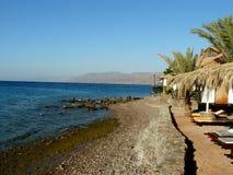 Spiaggia di pietra in Grecia Immagini Stock Libere da Diritti