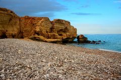 Spiaggia di pietra a Tiwi Immagini Stock