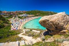 Spiaggia di Rena Bianca beach with red rocks and azure clear water, Santa Terasa Gallura, Costa Smeralda, Sardinia, Italy.  stock image
