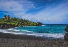 Spiaggia di sabbia del nero di Waianapanapa Fotografia Stock Libera da Diritti