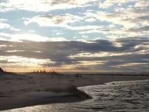 Spiaggia di tramonto Fotografie Stock