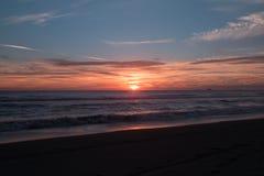 Spiaggia e cielo di tramonto Fotografia Stock